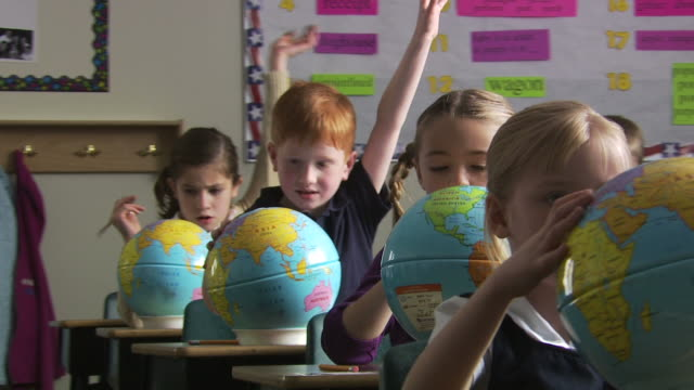 students with globes - see other clips from this shoot 1148 stock videos and b-roll footage