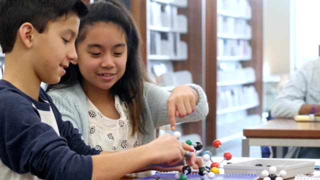 students work together to assemble molecular structure model - stem stock videos & royalty-free footage