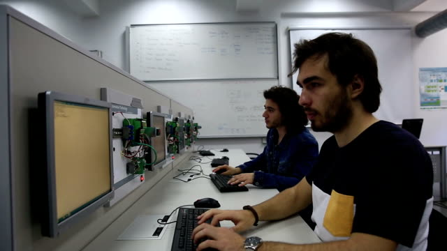 students working at control and automation laboratory - control stock videos & royalty-free footage
