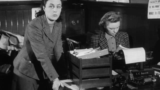 stockvideo's en b-roll-footage met montage students working in administration office / aberdeen, scotland, united kingdom - 1948