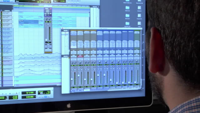 CU TD TU Studio engineer actively mixing audio on computer / New York City, New York, USA