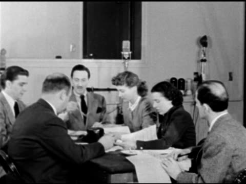 studio in use' light above 'b' door. producer & husband of rose franken, william brown maloney sitting at head of 'reading' table. mr. maloney... - scriptwriter stock videos & royalty-free footage