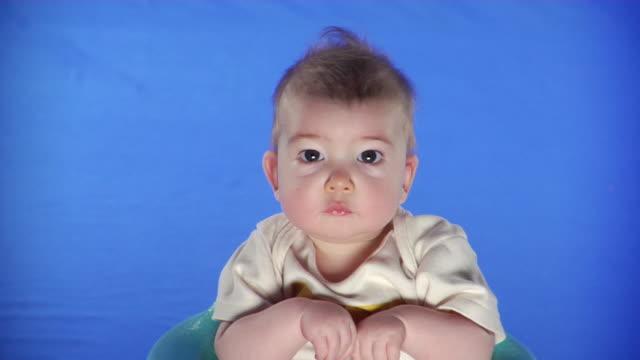 cu studio portrait of baby boy on blue screen - kelly mason videos stock videos & royalty-free footage