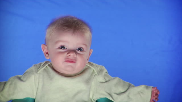 cu studio portrait of baby boy on blue screen - one baby boy only stock videos & royalty-free footage