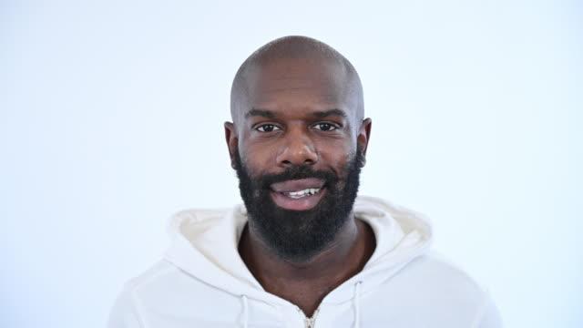 studio portrait of bearded black man in sweatshirt with hood - sweatshirt stock videos & royalty-free footage
