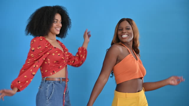 studio portrait of casual young black women dancing together - mid length hair stock videos & royalty-free footage