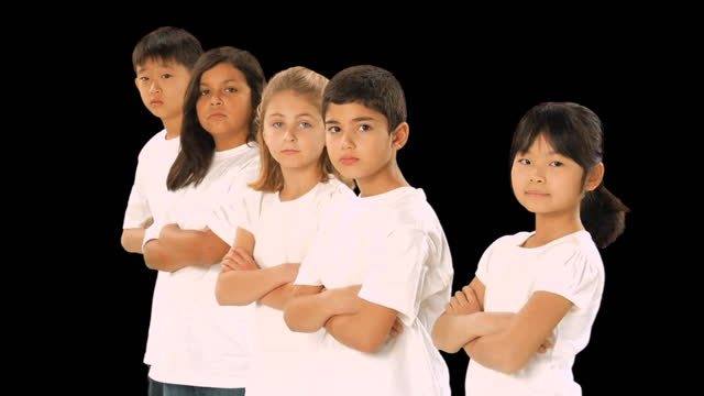 MS, Studio portrait of elementary school students (6-7) wearing white w-shirts