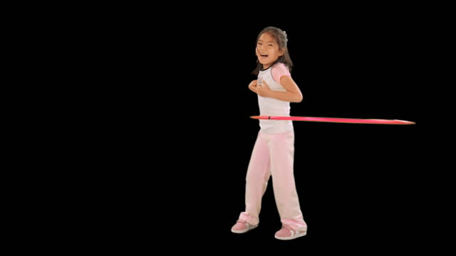 WS, Studio portrait of girl (6-7) hula hooping
