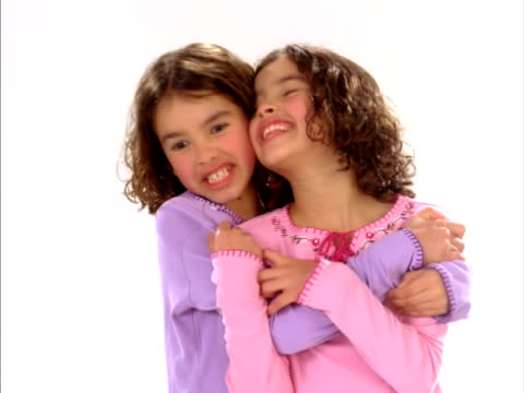 cu, studio portrait of identical twin sisters (8-9) hugging, raleigh, north carolina, usa - identical twin stock videos & royalty-free footage