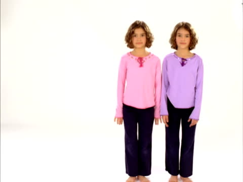 ws, studio portrait of identical twin sisters (8-9), raleigh, north carolina, usa - identical twin stock videos & royalty-free footage