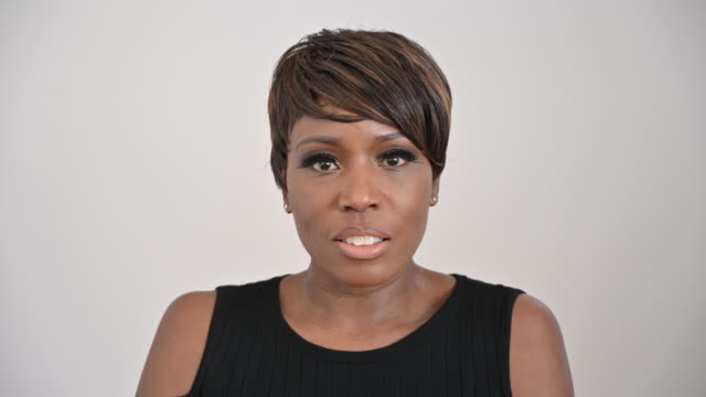 studio portrait of mature black woman with short brown hair - straight hair stock videos & royalty-free footage