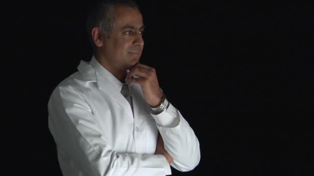 ZI, CU, Studio portrait of mature man in white coat
