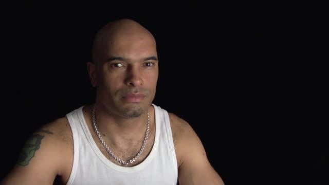 zi, cu, studio portrait of pensive man - tatuaggio video stock e b–roll
