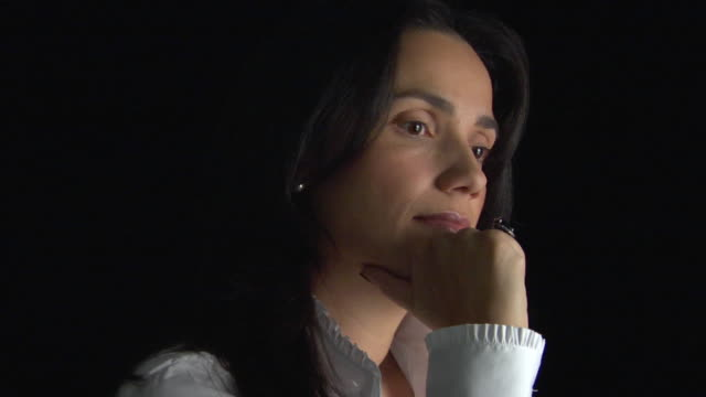 cu, studio portrait of pensive woman - kopfbild stock-videos und b-roll-filmmaterial