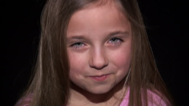 cu studio portrait of smiling girl (8-9) / orem, utah, usa - suspicion stock videos & royalty-free footage