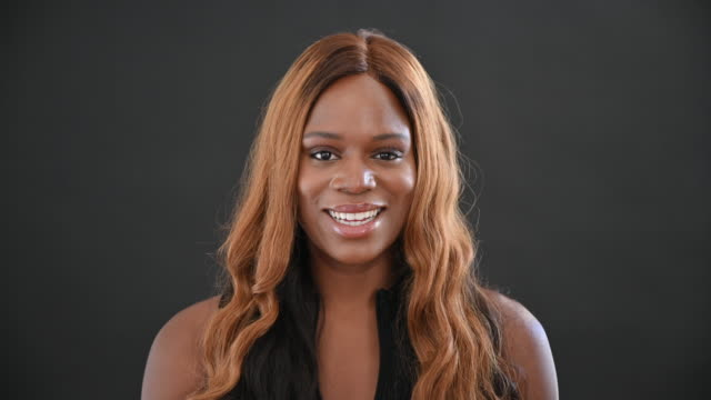 studio portrait of young black woman with long brown hair - sleeveless top stock videos & royalty-free footage