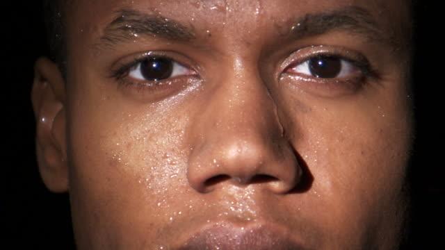 ecu studio portrait of young man with sweaty face / orem, utah, usa - extreme close up点の映像素材/bロール