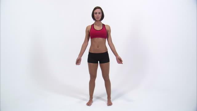 ws studio portrait of young woman in sports bra / orem, utah, usa - sports bra stock videos & royalty-free footage