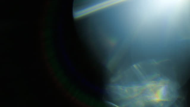 studio shot light leaks and lens flares - glass material stock videos & royalty-free footage