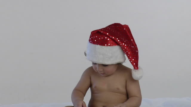 zi, cu, studio shot of baby boy (12-17 months) in santa hat playing with mobile phone, india - 12 17 months stock videos & royalty-free footage