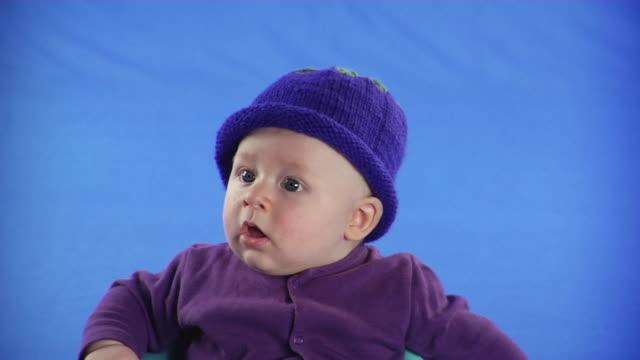 cu studio shot of baby boy on blue screen - kelly mason videos stock videos & royalty-free footage