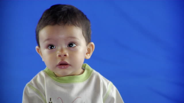 CU Studio shot of baby boy (6-11 months) on blue screen