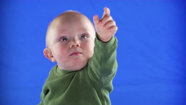 cu studio shot of baby boy (12-17 months) on blue screen - kelly mason videos stock videos & royalty-free footage