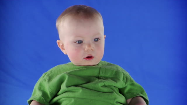 cu studio shot of baby boy (6-11 months) on blue screen - 6 11 months stock videos & royalty-free footage