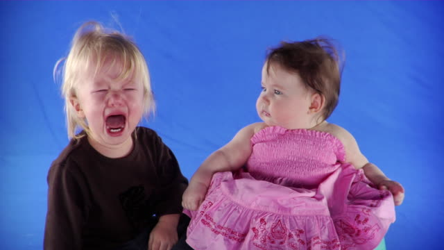 ms studio shot of baby girl (6-11 months) and baby boy (12-17 months) on blue screen - babies only stock videos & royalty-free footage