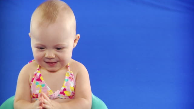 cu studio shot of baby girl (6-11 months) in bikini top on blue screen - kelly mason videos stock videos & royalty-free footage