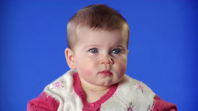 CU Studio shot of baby girl (6-11 months)) on blue screen