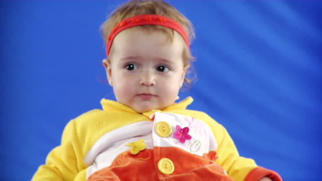 cu studio shot of baby girl (12-17 months) on blue screen - 12 17 months stock videos & royalty-free footage