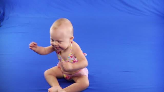 ws studio shot of baby girl (6-11 months) wearing  bikini on blue screen - kelly mason videos stock videos & royalty-free footage