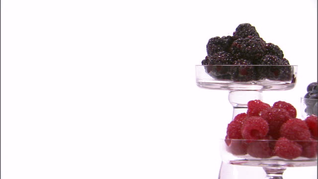 zi cu studio shot of berry fruits on glass cake stands - brambleberry stock videos & royalty-free footage