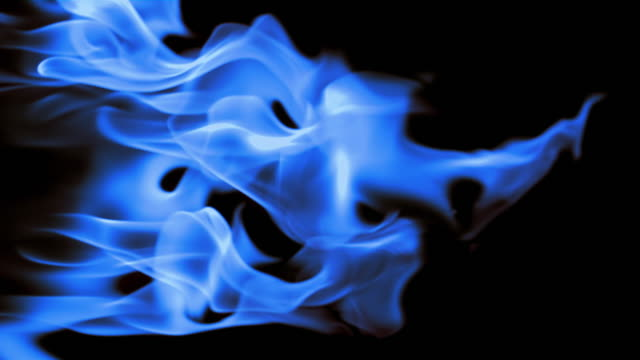 vidéos et rushes de slo mo cu studio shot of blue flames against black background - flamme