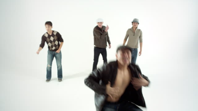 ws ms studio shot of boy band dancing and singing - boy band stock videos & royalty-free footage