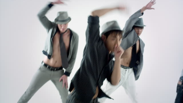 ms studio shot of boy band dancing - pop musician stock videos & royalty-free footage