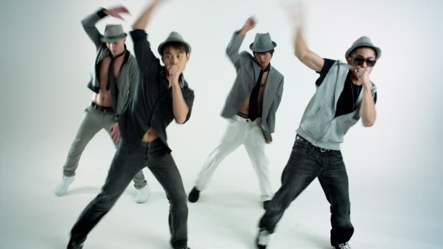 ms studio shot of boy band dancing - boy band stock videos & royalty-free footage
