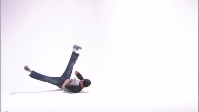ws studio shot of boy (14-15) break dancing / orem, utah, usa - only teenage boys stock videos & royalty-free footage