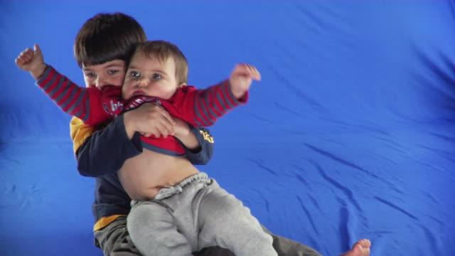 ms studio shot of boys playing on blue screen - kelly mason videos stock videos & royalty-free footage