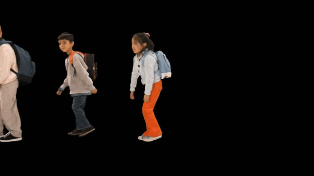 ws, studio shot of children (6-7) with backpacks walking slowly across screen arm in arm - ganzkörperansicht stock-videos und b-roll-filmmaterial