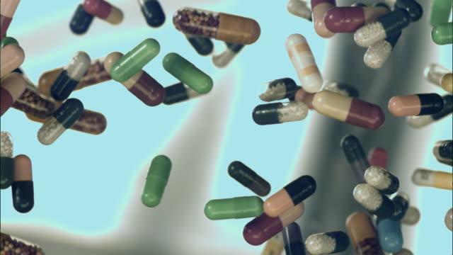 slo mo cu studio shot of colorful capsules mid air - capsule stock videos & royalty-free footage