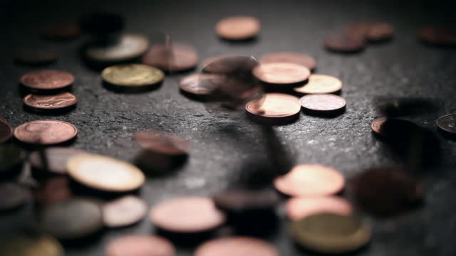 ecu selective focus studio shot of euro coins falling on ground - european union coin stock videos & royalty-free footage