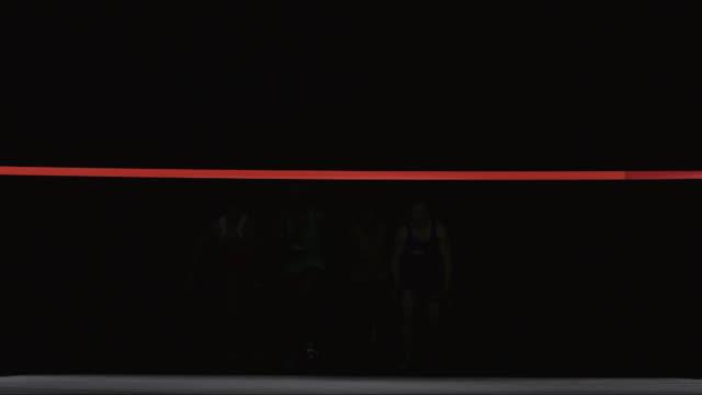 slo mo ws studio shot of four sprinters at finishing line - 完了する点の映像素材/bロール