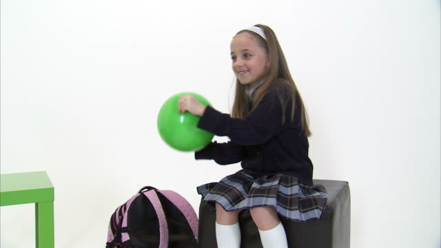 ms studio shot of girl (8-9) catching green ball / orem, utah, usa - hair accessory stock videos & royalty-free footage