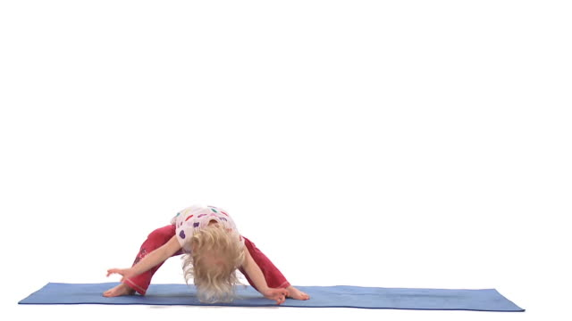 ws studio shot of girl (2-3) doing yoga wide legged forward bend pose on exercise mat - legs apart stock videos and b-roll footage