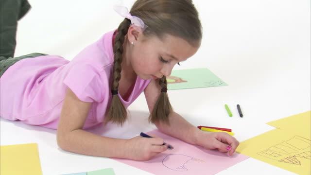 MS Studio shot of girl (8-9) drawing / Orem, Utah, USA