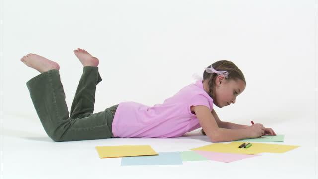 ms studio shot of girl (8-9) drawing / orem, utah, usa - crayon stock videos & royalty-free footage