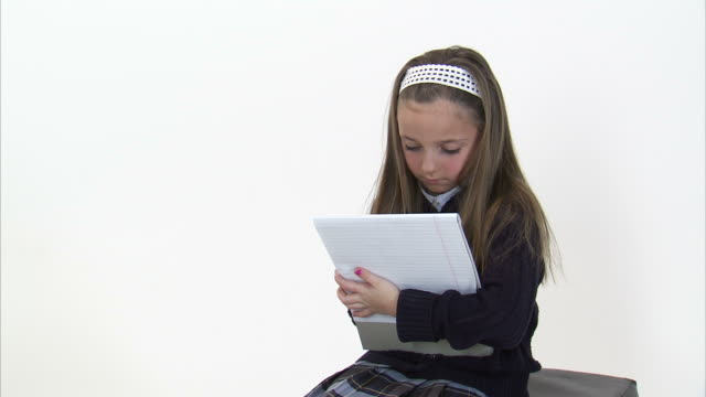 ms studio shot of girl (8-9) writing in notebook / orem, utah, usa - hair accessory stock videos & royalty-free footage