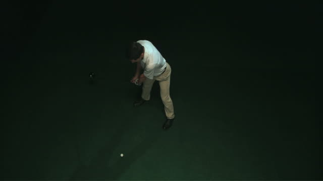 slo mo ws ha studio shot of golf player teeing off - tee off stock videos & royalty-free footage